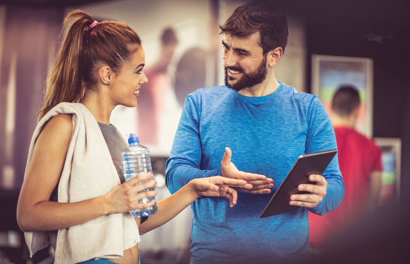 Qualified Personal Trainer Working With Client