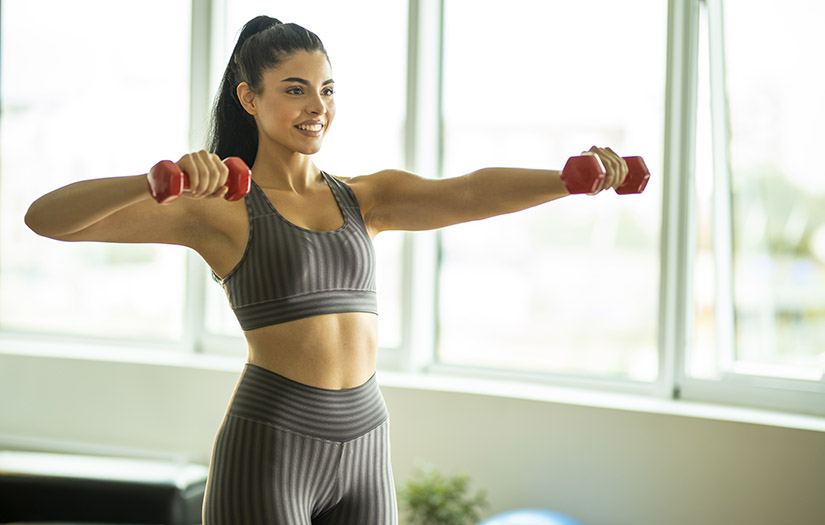 a woman doing an arm workout with weights
