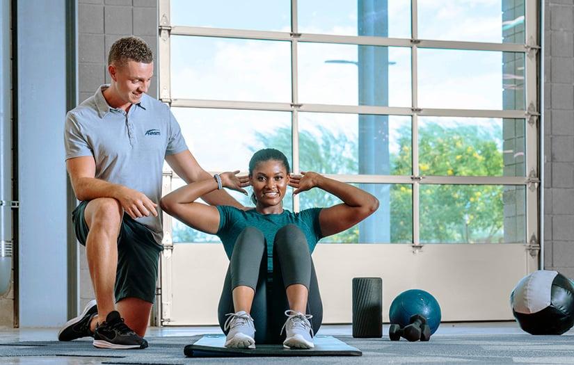 trainer training a pt client
