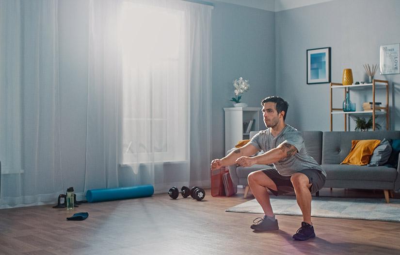 man doing a bodyweight squat