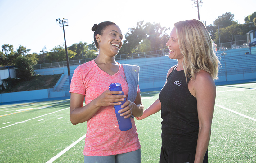 personal trainer giving a client a consultation