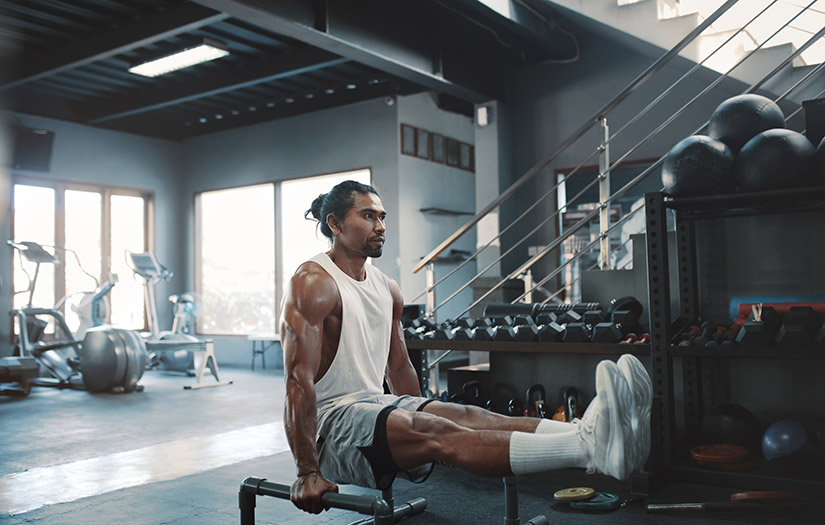 man doing a parallette workout for his triceps