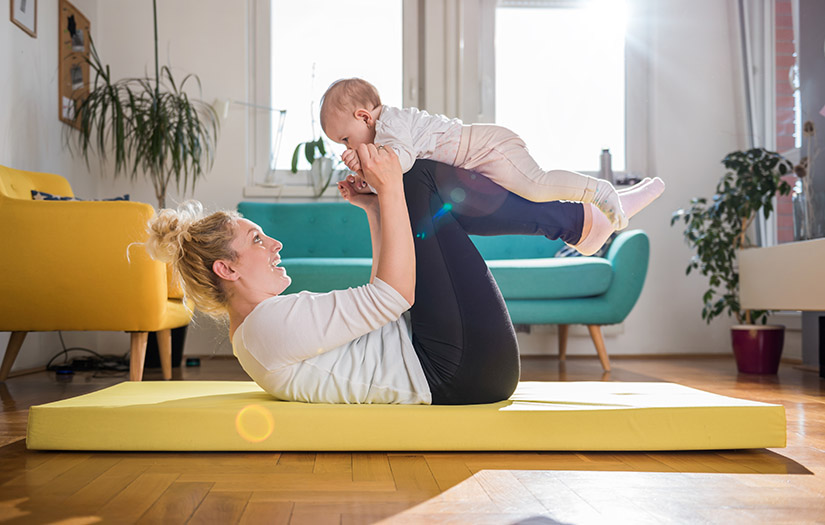 mother working out with her baby