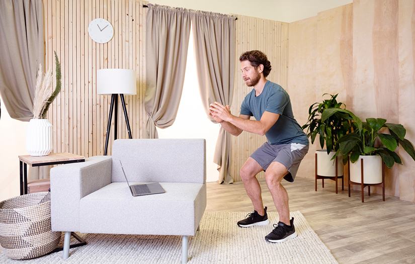 personal trainer using technology to teach a fitness class