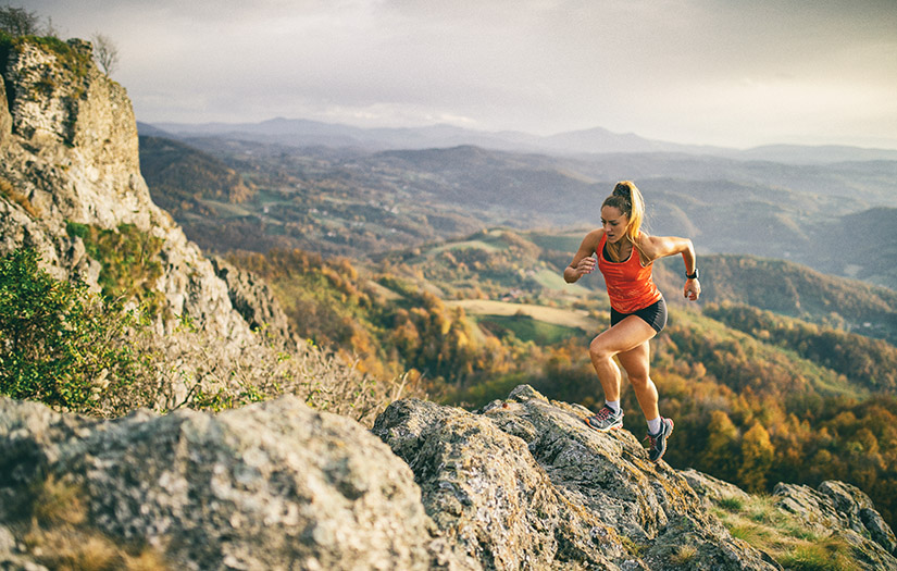 woman running on mountain